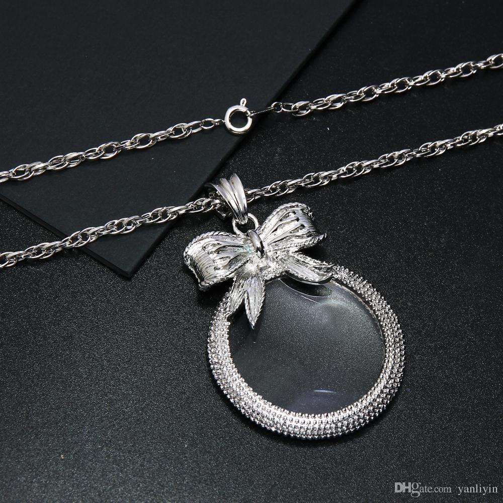 Conception de l'arc mignon loupe collier mode loupe lunettes pour lire pendentif avec chaîne