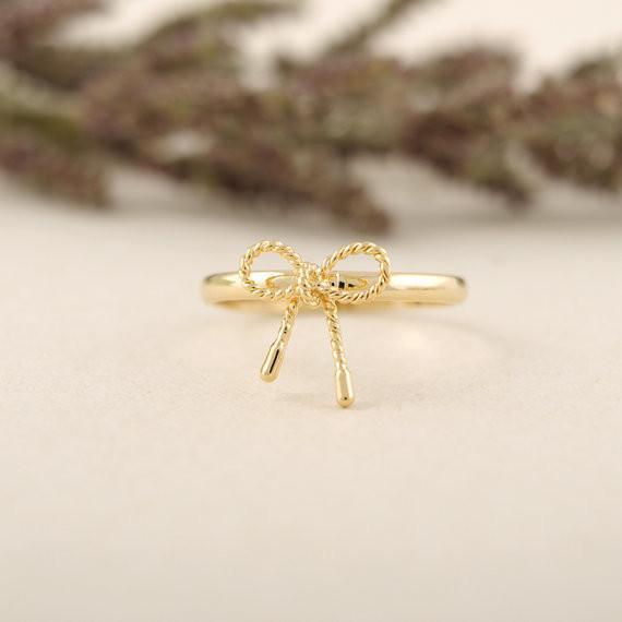 Les derniers éléments anneaux pour les filles Fashion bow ring, bagues de soudage manuel pur, anneau de cuivre en gros livraison gratuite