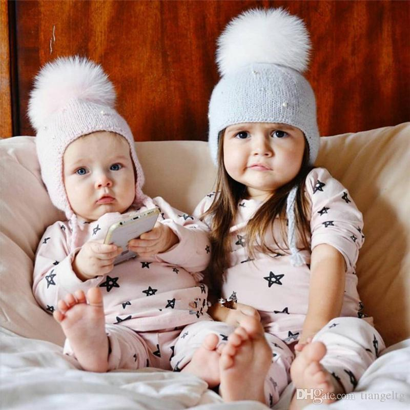 4f9a4e81ccc 2019 Baby Pom Ear Caps Pearl Beads Knitting Wool Bobble Beanies Braid Autumn  Spring Newborn Boys Girls Photography Prop Crochet Hats Cap From Tiangeltg