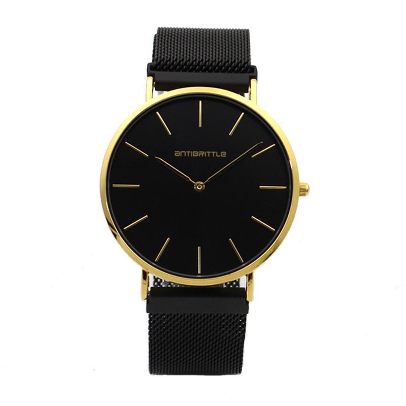 9894995b195a Compre Cuarzo De Lujo Negro Oro Hombres Reloj Minimalista Ultra Thin Magnet  Acero Inoxidable Correa De Cuero Real Reloj De Pulsera 6 Mm Clásico A   23.43 Del ...