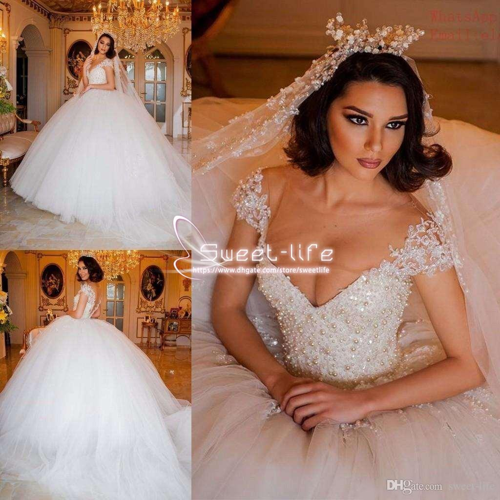 Luxurious 2019 Ball Gown Wedding Dresses Jewel Short Sleeves Illusion Backless Beaded Collar Empire Tulle Sweep Plus Size Train Bridal Gowns