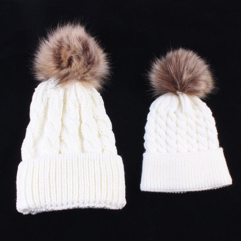 af6bcddc82a 2019 2018 Mother Kids Child Baby Warm Winter Knit Beanie Fur Pom Hat  Crochet Ski Cap Cute 2017 New Arrival Mom And Baby Knited Hats From  Jerry011