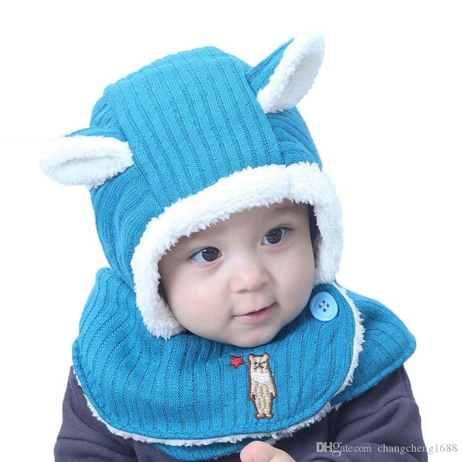 2e33ec57140 2019 Winter Baby Girl Boys Hat Scarf Kids Knitted Hooded Scarf Child Rabbit  Ear Beanie Earflap Cap Warm Circulal Scarves Solid MZ7034 From  Changcheng1688