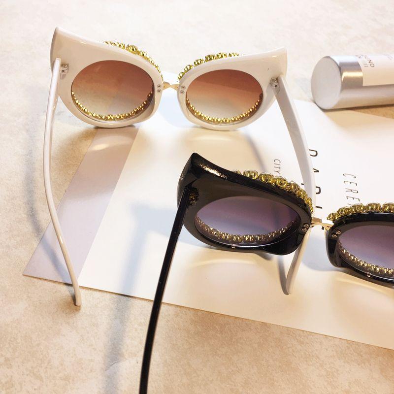 Occhiali da sole di lusso da donna Designer di marca Strass di lusso Sexy Cat Eyes Occhiali da sole Vintage Shades Eyewear