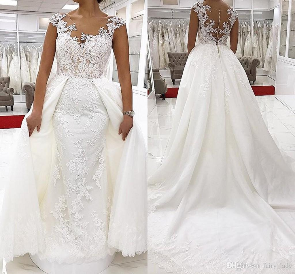 Discount Stunning Overskirts Lace Country Wedding Dresses With Capped  Sleeves 2018 Sheer Neck White Long Vestido De Noiva Women Bridal Gowns  Trendy Wedding ... f2962243c