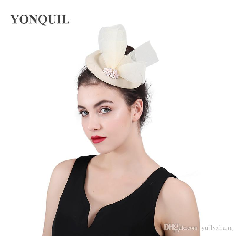 2019 Winter Charming Pillbox Fedora Hats Wedding Women Tulle Bow Wool Felt  Fascinator For Party Show Race Royal Headwear Chapeau Caps SYF427 From  Yullyzhang ... 272d2d27b33