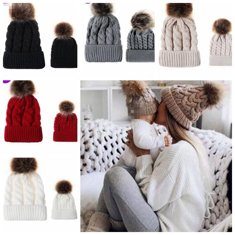 d8c3b21dbea55 2019 Mom Baby Matching Hats Winter Warm Knitted Girls Hats Mother Daughter  Pompom Knit Family Matching Hat KKA6008 From Best sports