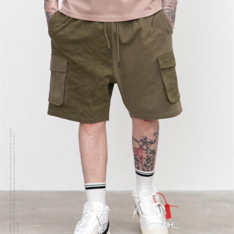 94a0d0b559ef4 Compre Verano De Gran Tamaño Pantalones Cortos De Hip Hop Pantalones Cortos  De Skate Para Hombre Pantalones Cortos De Harem Hombres De Camuflaje Split  A ...