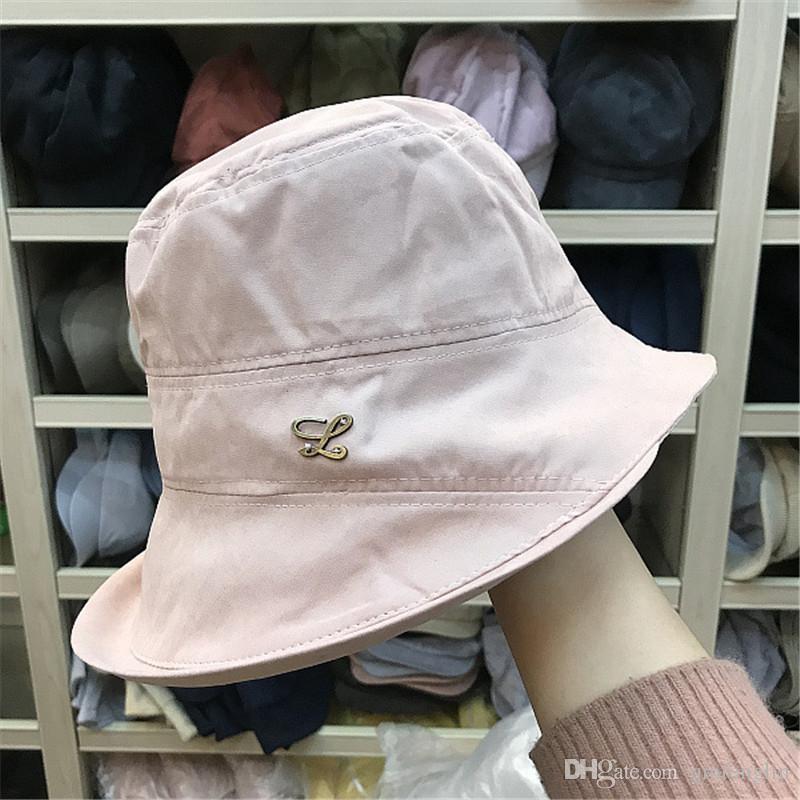 Cappello a secchiello da donna in cotone tinta unita pesca in spiaggia Cappello estivo a tinta unita in cotone donna Design alla moda Pieghevole con fiocco in lana