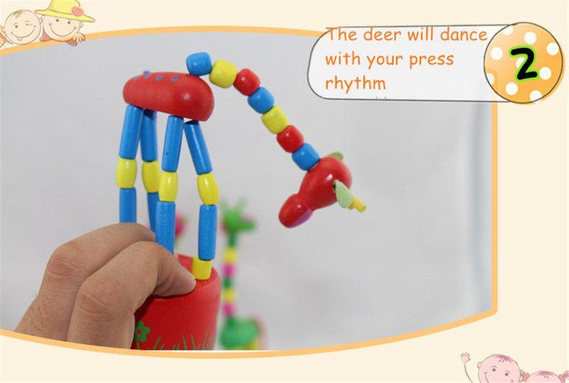 Juguete de madera de la jirafa de la roca de pie que baila la muñeca de la mano 18cm Juguete animal alto Niños Juegos de la novedad Juguetes es Originalidad de los niños Regalo de la nave libre