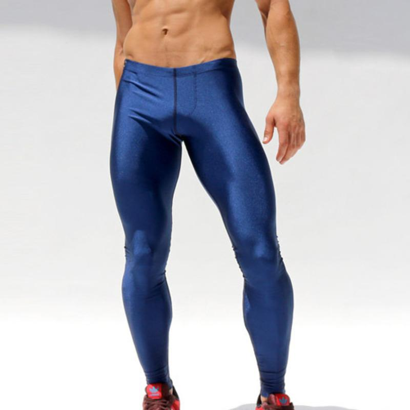 25fd89babe3 2019 Solid Mens Leggings Running Tights Men Compression Pants Sexy Fitness  Gym Basketball Tights Male Workout Athletics Leggins Wear From Kuyee