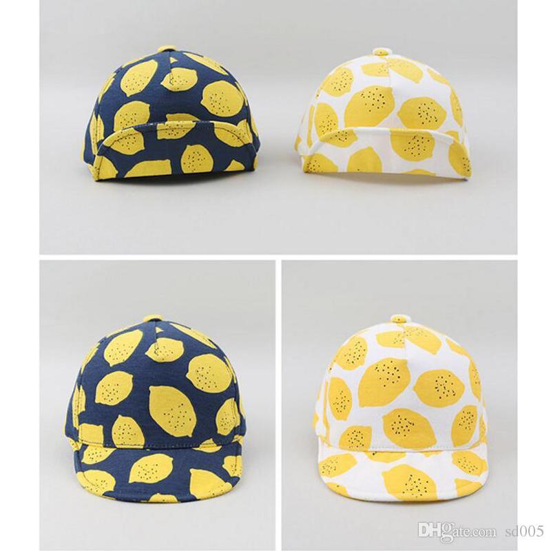 35a2a36029078 Pure Cotton Baseball Cap Lemon Printing Fashion Lovely Magic Sticker Adjustable  Baby Peaked Caps Sun Hat 7tj U U Headwear Flat Caps From Sd005