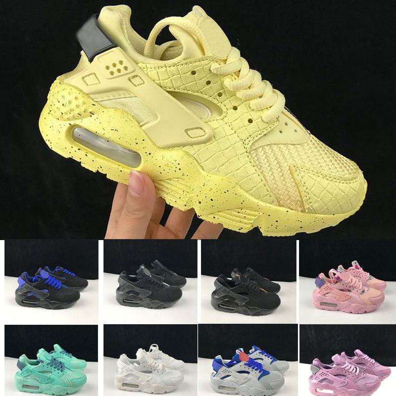 pretty nice 534a9 ff983 Compre 2018 Nike Air Huarache 1 3 4 New Air Huarache Running Zapatillas  Zapatillas Grandes Niños Niños Niñas Hombres Y Mujeres Negro Blanco Zapatos  Al Aire ...