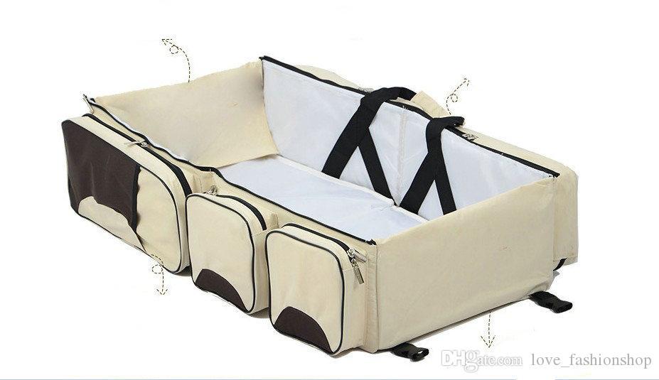 Venta al por menor Portátil Bolsa de cama de bebé plegable Multifunción Mamá grande Bolsas al aire libre Mano para el exterior Cama de seguridad para bebés Bolsa de seguridad para bebés Pañales Pañales Tote