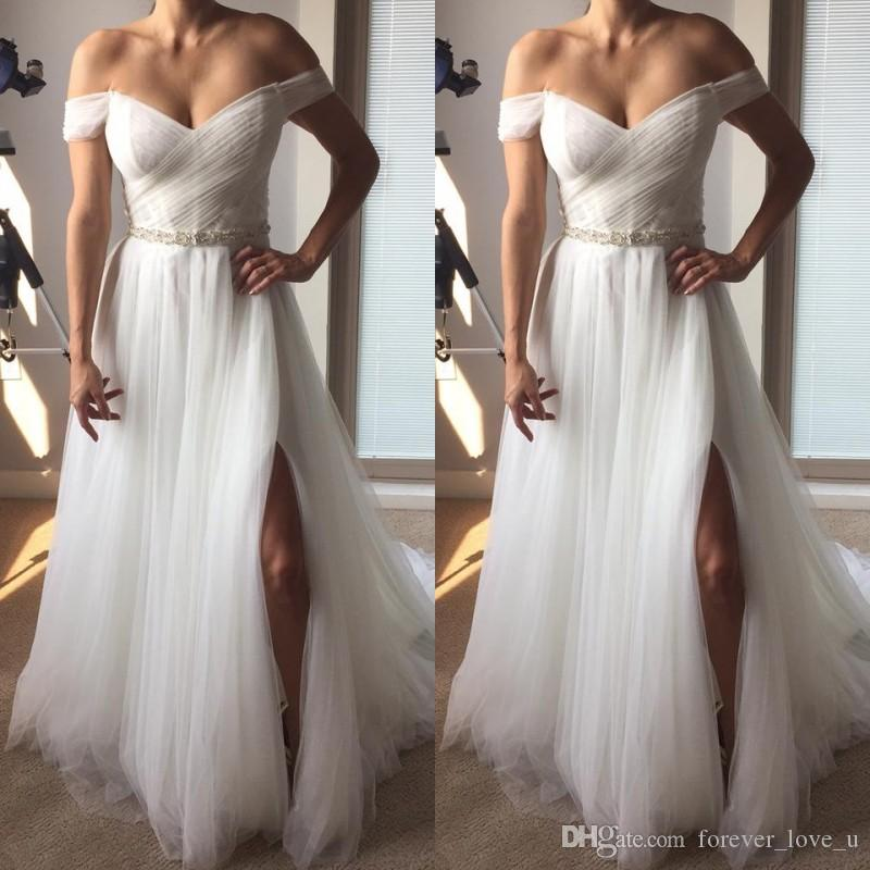 Discount 2019 Stunning Beach Wedding Dresses Off The Shoulder Lace Tulle  Ruched Top High Split Bridal Gowns Exquisite Beaded Belt Sweep Train  Destination ... 0f9495ea1975