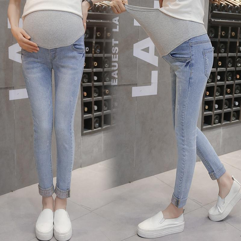 7bb9e6e0b Compre Cintura Elástica Parche Estiramiento Denim Maternity Belly Jeans  Otoño Primavera Pantalones Ropa Para Mujeres Embarazadas Pantalones Lápiz  Embarazo A ...