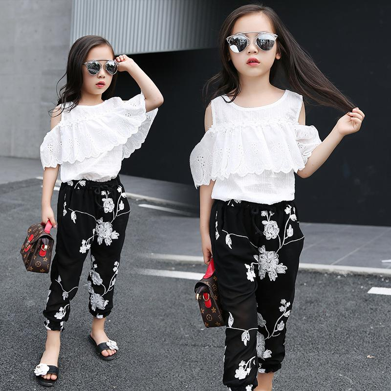 f3cb62671 Compre 2018 Summer Kids Fashion Girls Ropa Conjuntos 2 Unids Blusa De Encaje  Blanco Top Negro Flores Pantalones Set Para Niñas Adolescentes Ropa Set ...