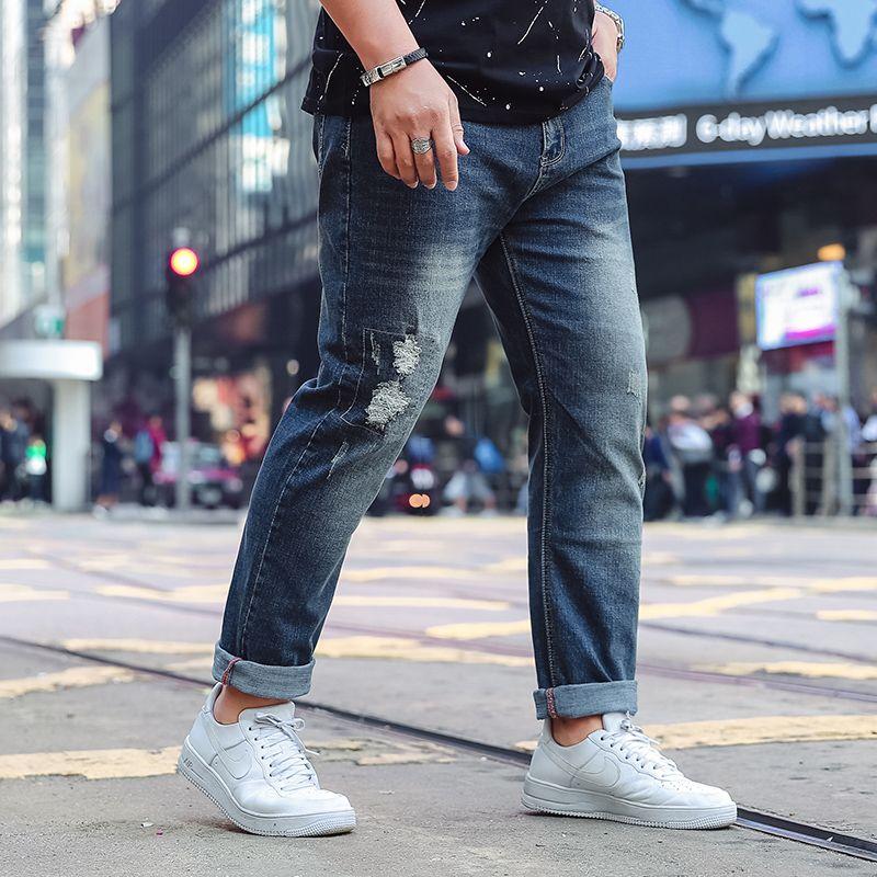 4b0c0dd552f 2019 2018 Spring Men S Hole Cuffs Hem Jeans Elastic Comfortable Cowboy  Casual Denim Trousers High Quality Large Size 5XL 6XL 7XL 48 From Chikui