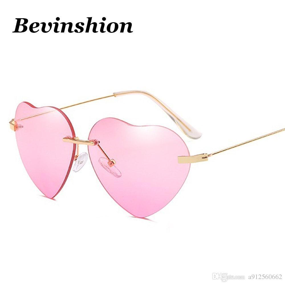 Compre New Coração Sem Aro Óculos De Sol Mulheres Cor Do Oceano Rosa Vintage  Cat Eye Óculos De Sol Lady Amor Em Forma De Casal Gradiente Eyewear Marca  De ... 822deb0f30