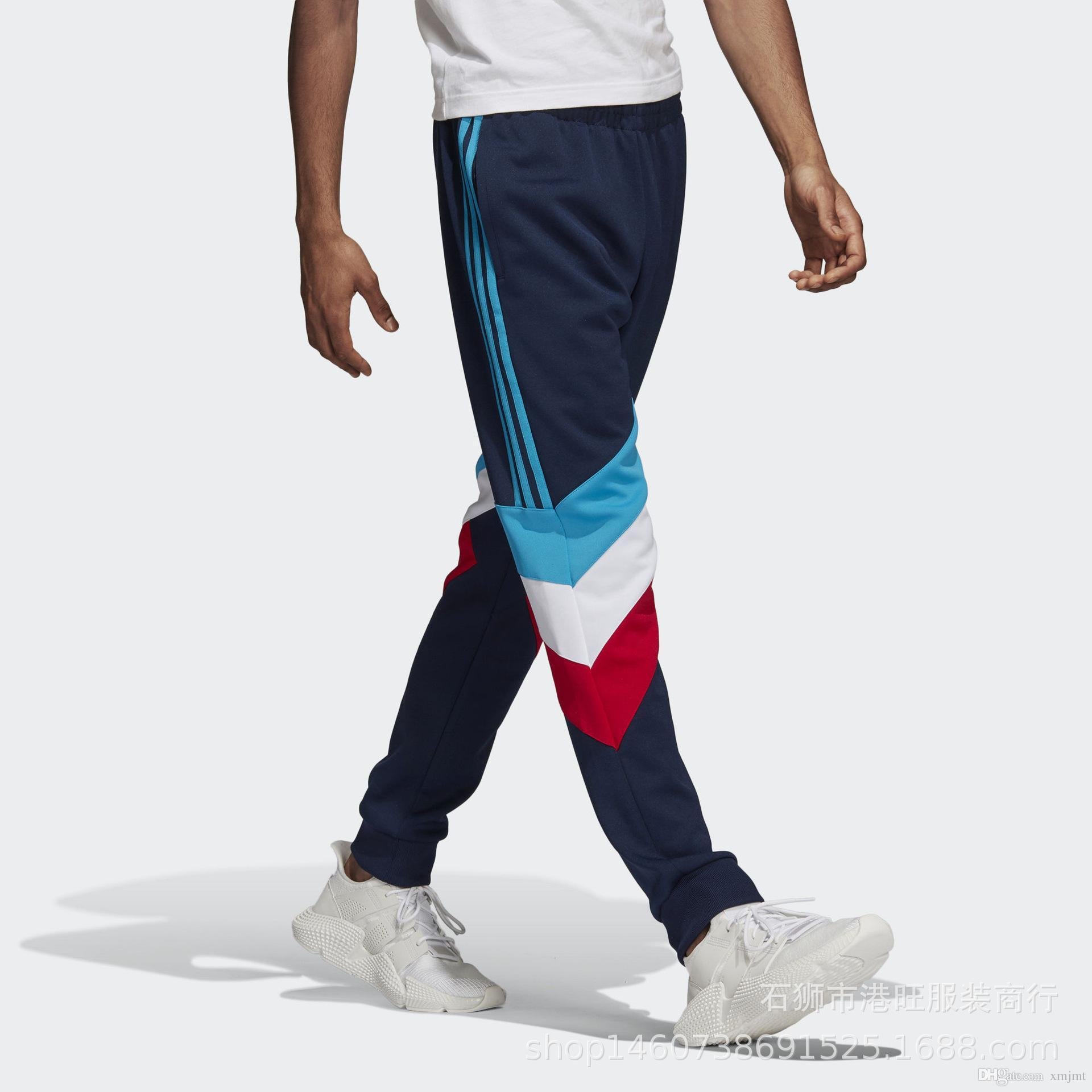 80d6a39e5e Compre 2018 Otoño Hombres Moda Coser Pantalones Deportivos De Algodón Casual  Pantalones Para Correr Marea Juvenil Marca Pantalones Nuevo Estilo Al Por  Mayor ...
