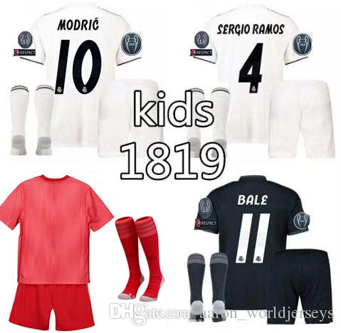 check out b8d0d 23f58 Ramos ninos Real Madrid kid red Gareth Bale equipacion champion league  soccer Jerseys Luka Modric realmadrid ISCO Bale football kits 2018/19