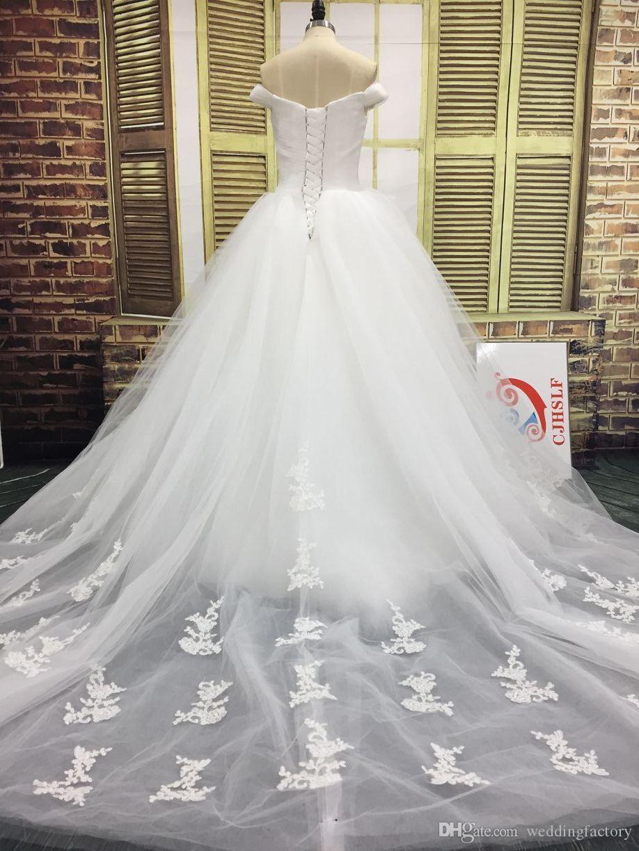 Vestidos de novia con encanto Vestidos de novia Fuera del hombro Apliques de tul con pliegues Vestido de novia en la espalda con tren adjunto hinchado
