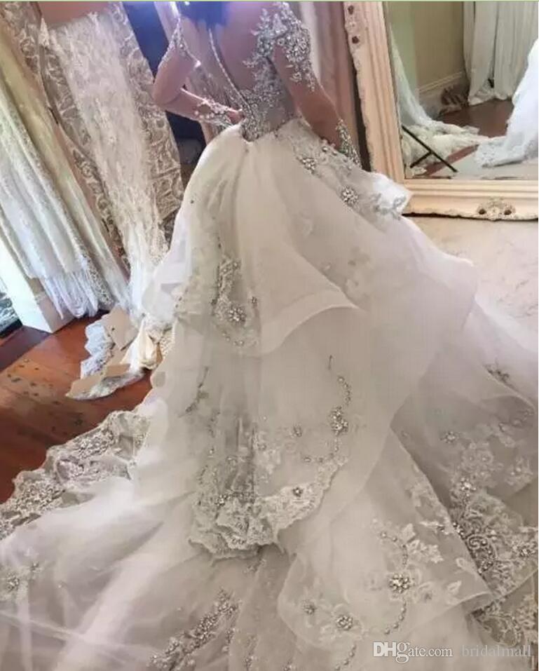 De plata con cuentas vestidos de boda del cordón de la sirena sobrefaldas altos vestidos de novia africanos cuello Sheer botones de nuevo vestidos de boda Vestidos de novia