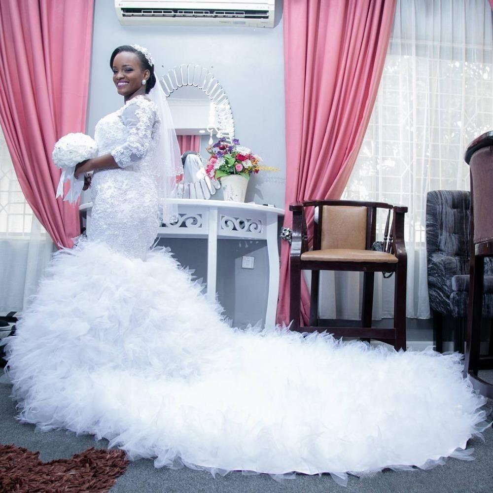2018 Incredibile africano sexy off spalla in rilievo pizzo abiti da sposa sirena 2019 cappella treno ruffles abiti da sposa robe de mariage plus size