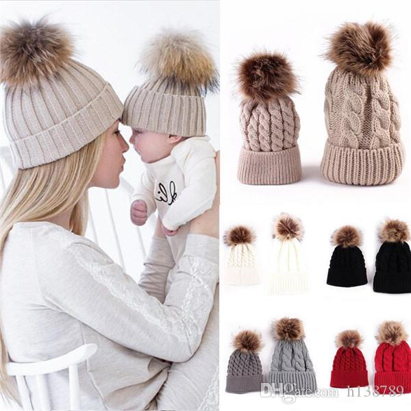 9fc073c6679 2019 Mother Kids Child Baby Warm Winter Knit Beanie Fur Pom Hat Crochet Ski  Cap Cute Toddler Girls Boys Warm Hat From H138789