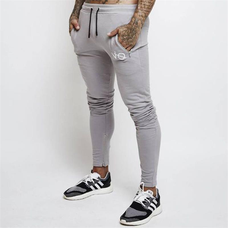 Compre Pantalones De Chándal Grises Pantalones Para Correr A Rayas Hombres  Deporte Lápiz Hombres Algodón Suave Culturismo Joggers Gimnasio Pantalones  Mallas ... 16a318758dc1