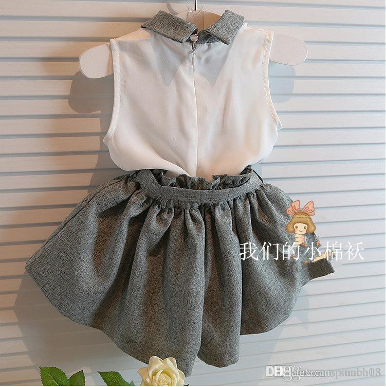 Hot Summer Girls Sets Baby Kids traje de dos piezas de gasa Tops blanco chaleco + Bowknot Shorts Girl trajes niños Set 1502