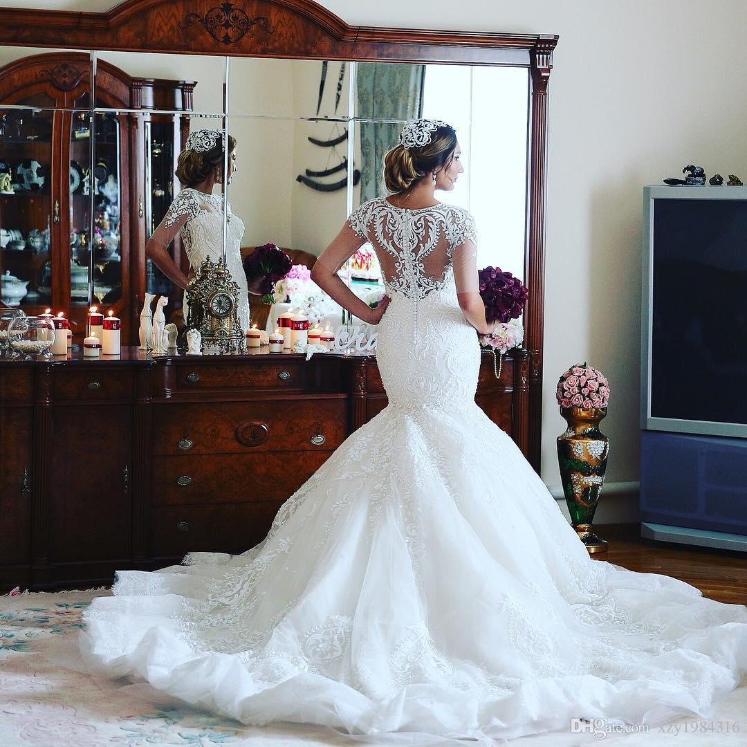 Elegant Dubai Mermaid Wedding Dress Jewel Neck Half Sleeve Beads Lace Applique Bridal Dress Charming Africa Arabia Tulle Long Wedding Gowns