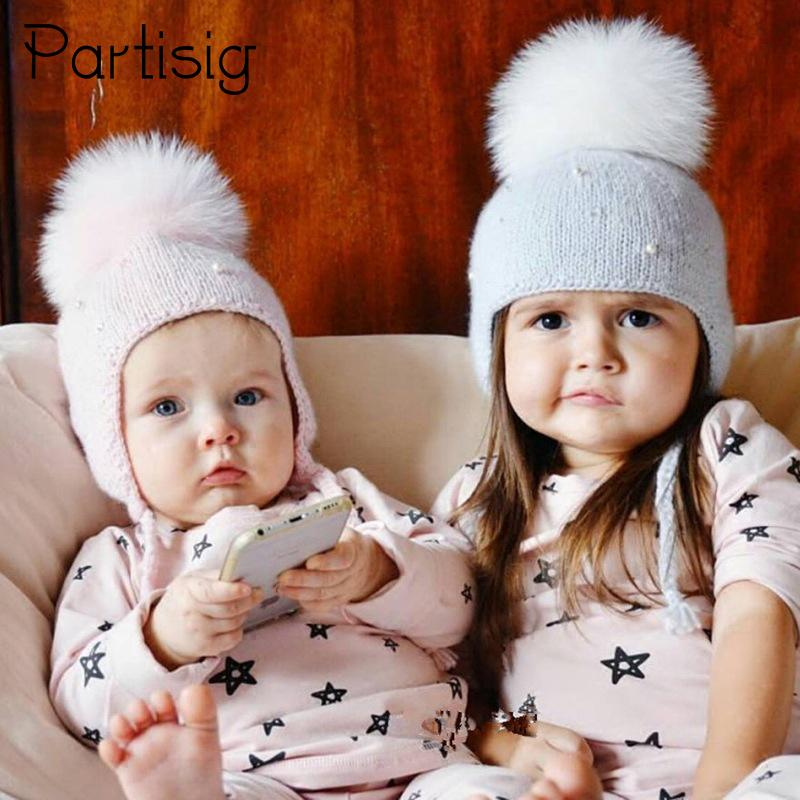 82b6093b1f276 2018 Baby Hat Winter Pearl Girls Cap Artificial Fur Ball Baby Boy Hats  Infant Earflap Caps Wool Knitted Children s Hats Caps For Kids