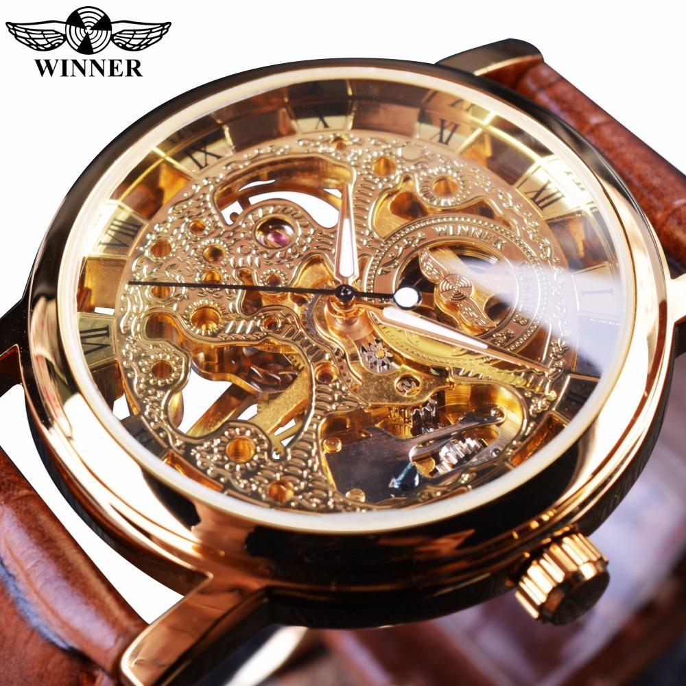 f14e2933fe2 Compre Vencedor Transparente Caixa De Ouro De Luxo Casual Design Pulseira  De Couro Marrom Mens Relógios Top Marca De Luxo Esqueleto Mecânico Relógio  S923 De ...