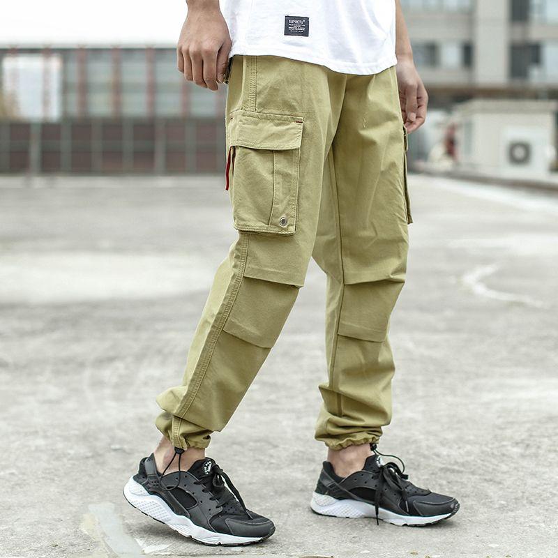 7a837fc89538da 2019 2018 Fashion Men Jeans Casual Pants Khaki Color Loose Fit Cotton Jogger  Pants Brand Designer Big Pocket Jeans Men Cargo From Beke,  51.75    DHgate.Com