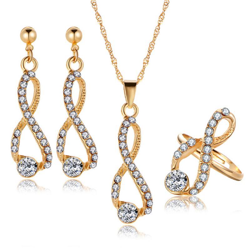 4ef3f6fcecfd Compre Juego De Joyas Cristal Pendientes Largos De Collar Anillos De Color  Oro Diseño Simple Joyas De Boda Para Mujer A  33.82 Del Fujinplea