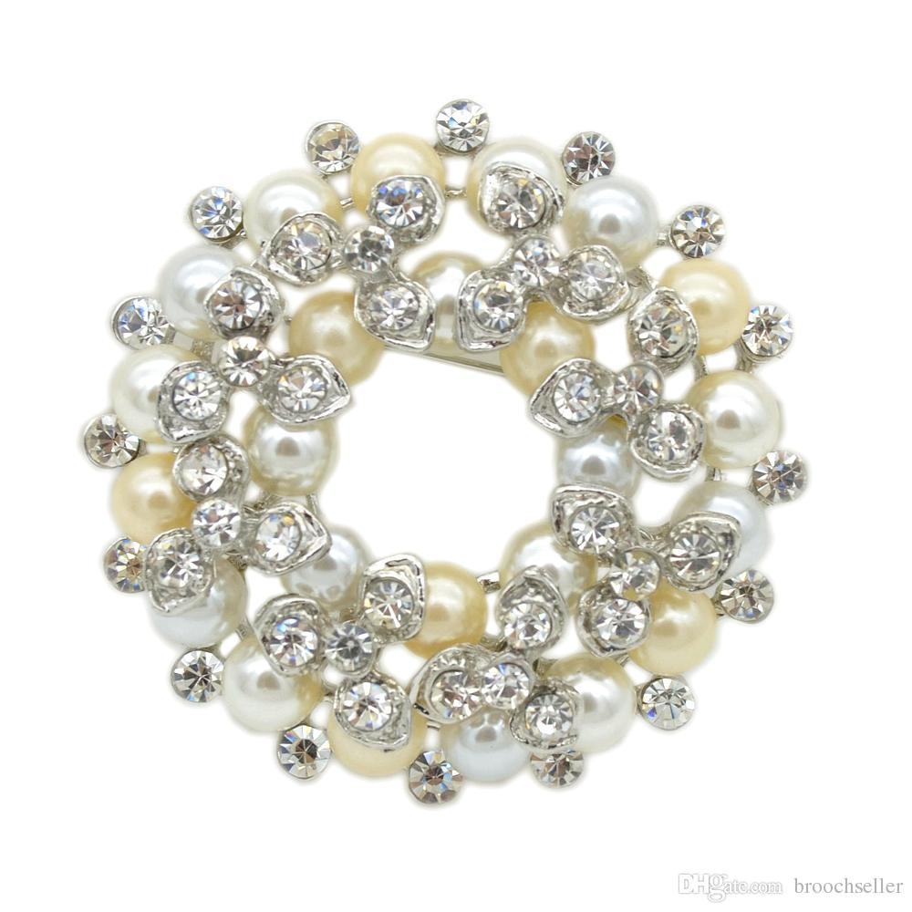 Broche en forme de perle d'ivoire plaquée argent et broche en cristal strass transparent