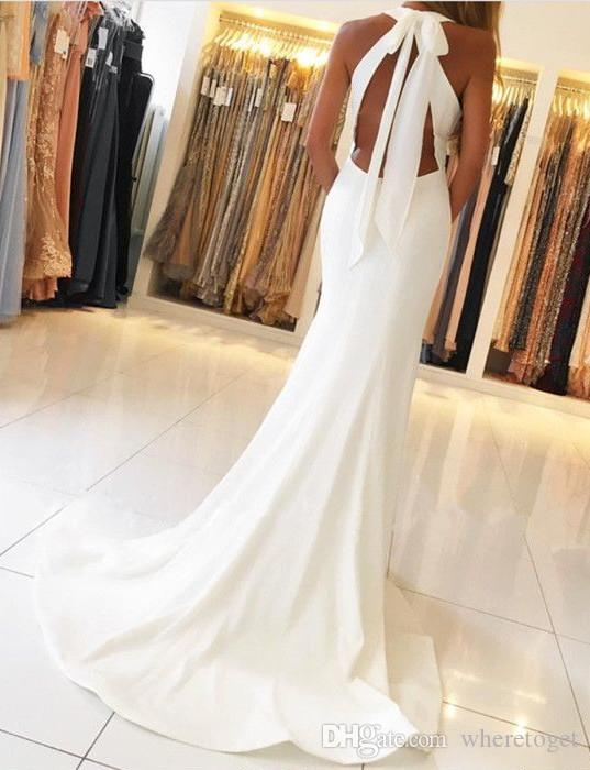 Cheap 2018 Arabic side split white evening dresses mermaid elegant floor length halter backless satin long formal prom party gowns plus size