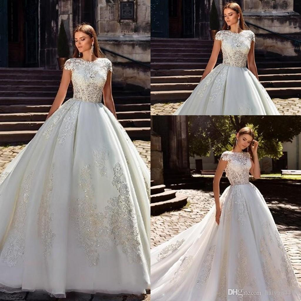 2018 New Cheap Modern Ball Gown Wedding Dresses Illusion Cap Sleeves Lace  Appliques Beaded Organza Arabic Plus Size Formal Bridal Gowns Bridal Bridal  Gowns ... 841ef8352
