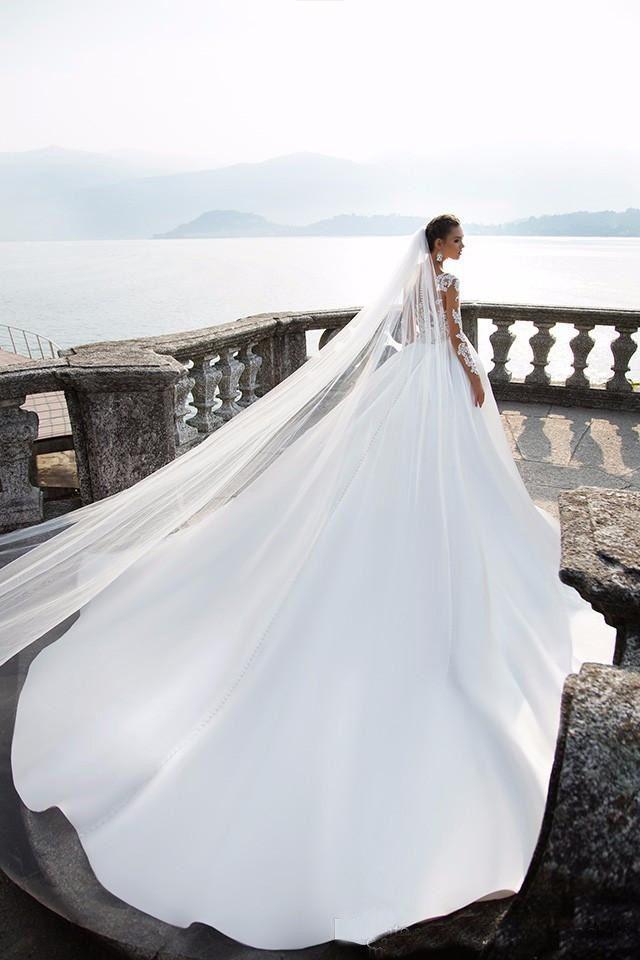 2017 Milla Nova Sheer Long Sleeve Wedding Dresses Jewel Neck Lace Appliques Satin Ball Gown Bridal Gowns Beach Wedding Gowns