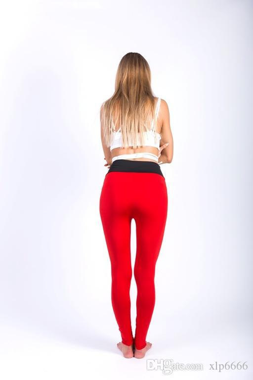 Avrupa ve amerikan sıcak tarzı basit kadın giyim eşleştirme bel yoga pantolon dikiş ve kalça tayt.