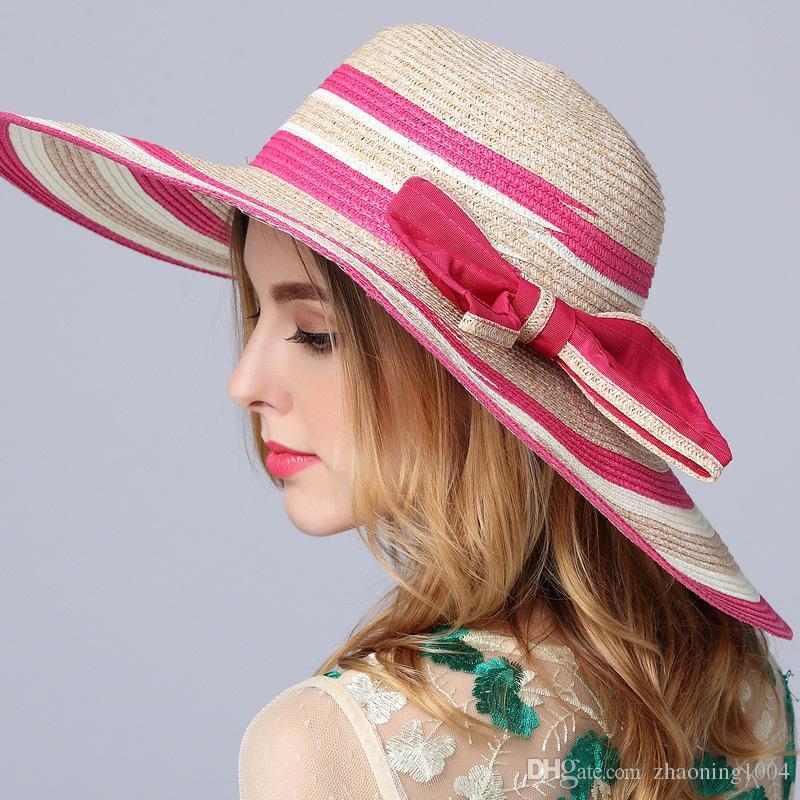 Elegant Big Straw Beach Hats With Bow Ladies Wide Brimmed Vietnam Floppy  Foldable Sun Hat Women Caps UA Protection Summer Bucket Hats Snapback Hats  Straw ... a1d44c6405c
