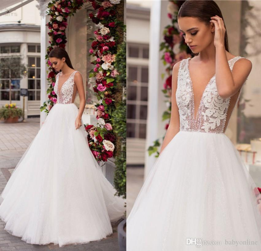 Discount 2019 Sexy Backless Wedding Dress V Neck Lace Appliqued Top Sheer  Ruched Tulle Floor Length Summer Garden Wedding Gowns Cheap Fashion Wedding  ... d8c5b37c5af0
