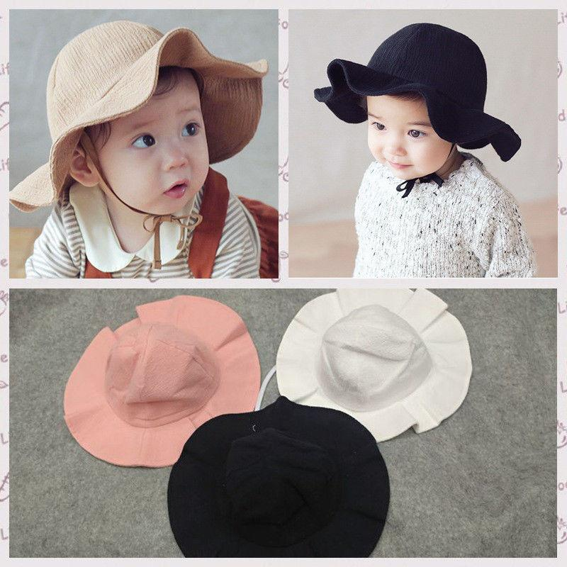 2018 Summer Infant Toddler Baby Kids Boy Girls Children Cap Sun Beach  Travel Cotton Wide Brim Hat Solid Cute Hats Caps UK 2019 From Namenew a47ba1d182da