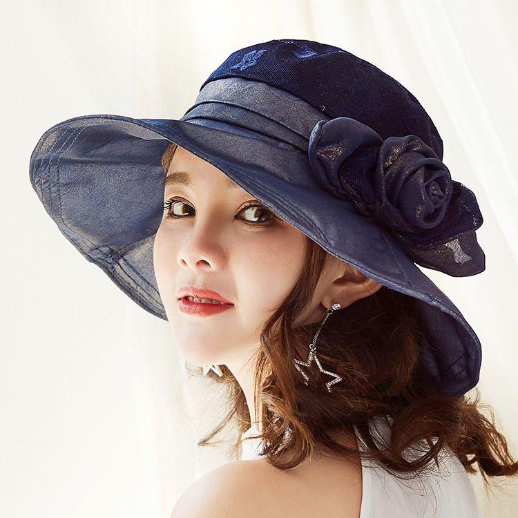 Acquista 2018 Nuovo Cappello Di Stoffa Moda Donna Di Alta Qualità Protezione  Solare Cappelli Da Sole Fiori Decorativi Ricamo UV Donne Cappelli Da Sole A  ... 75e818d7f410
