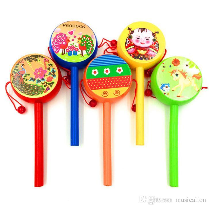 Manufacturers sell wooden rattling drum wooden stickers rattle drum toys for infants and children 18.5*3*7.5cm