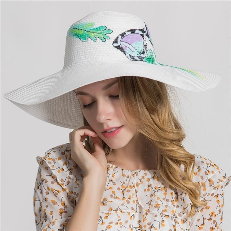 2018 Fashion Hot Graffiti Straw Hats Women Summer On Vaction Popular Sun Hat  Lady Beach Wide Brim Paper Bucket Hat Top Hats Cloche Hat From Playnice d714adc1947