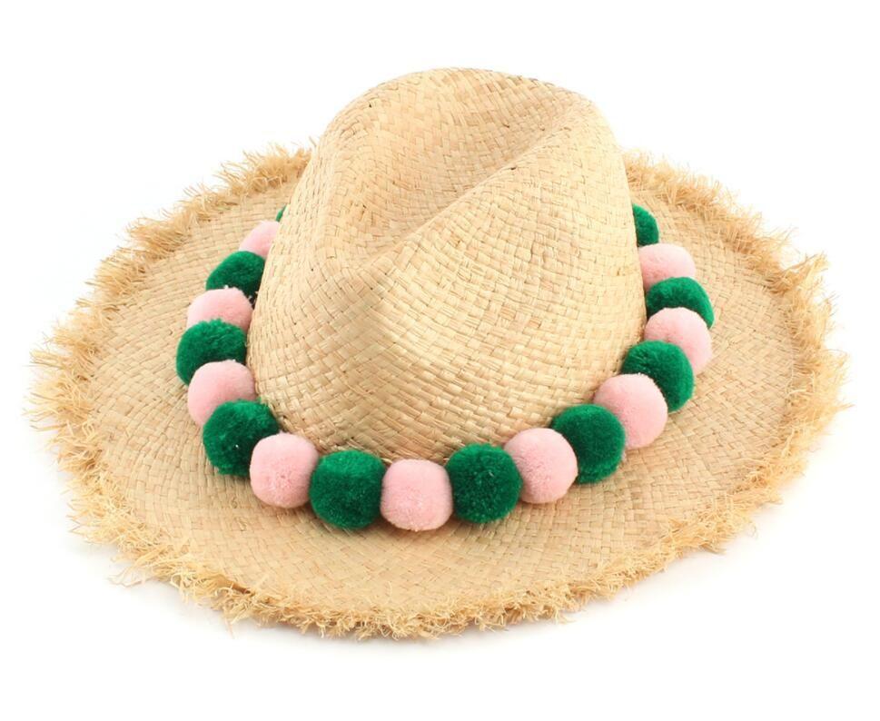 Fashion Ladies Raffia Straw Fedora Hat With Pom Poms 2018 Women Summer  Beach Nature Straw Fedoras Hats Wholesale Sun Caps Wide Brim Fedora Summer  Hat From ... 761b0fac4d8a
