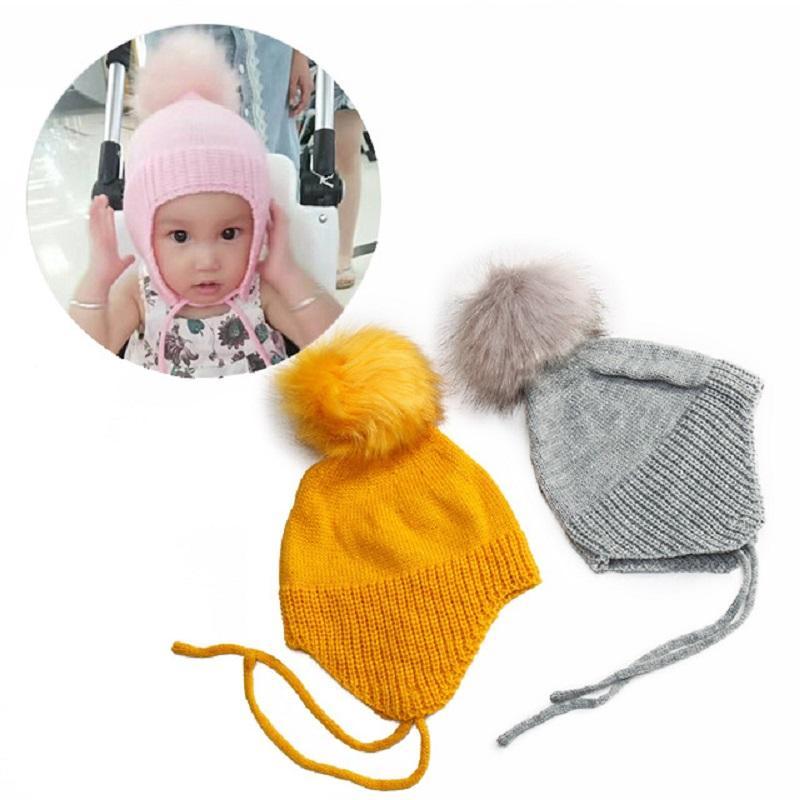 Großhandel Süße Pelz Pom Pom Baby Winter Hut Mütze Häkeln Gestrickte