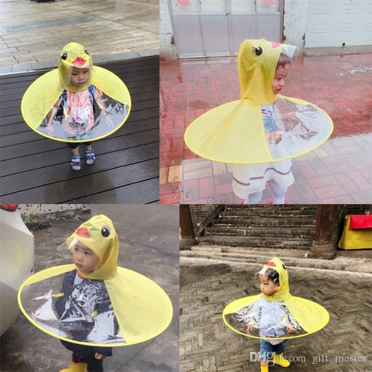 Creative Flying Saucer Children Raincoat Boneless Outdoor Play Cartoon  Yellow Duck Waterproof Umbrella Cover Hands Free Rain Hat Headwear J  Childrens Yellow ... 527009a0349e